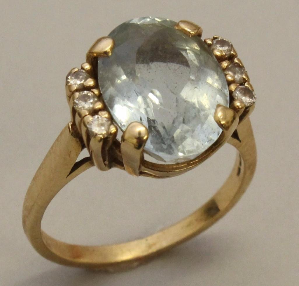 Gold Ring with Gemstone and Diamonds