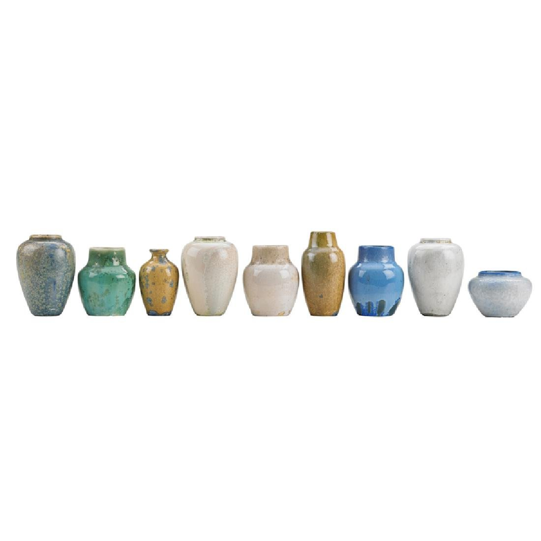 ADELAIDE ROBINEAU Nine small cast glaze test vases
