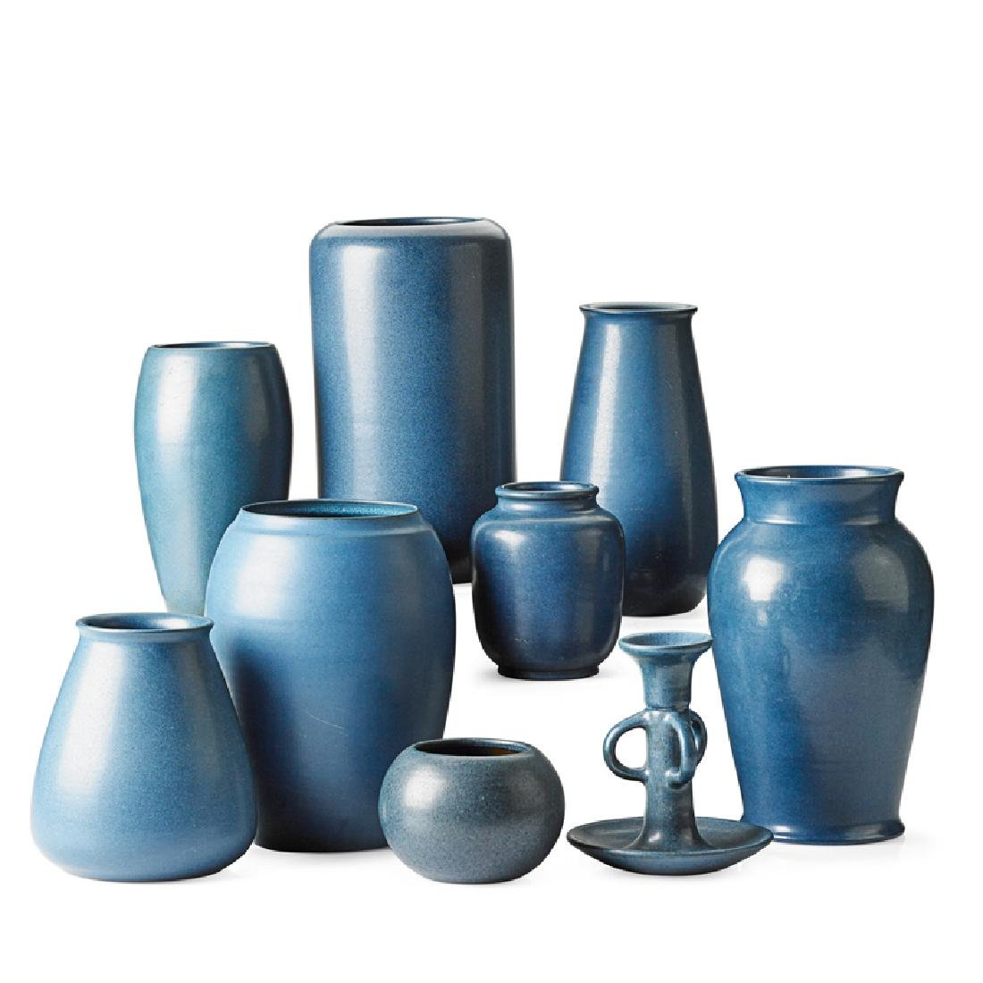 MARBLEHEAD Eight blue vases, one candlestick