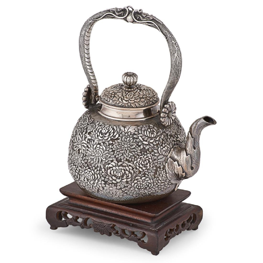 CHINESE SILVER REPOUSSE TEAPOT ON STAND