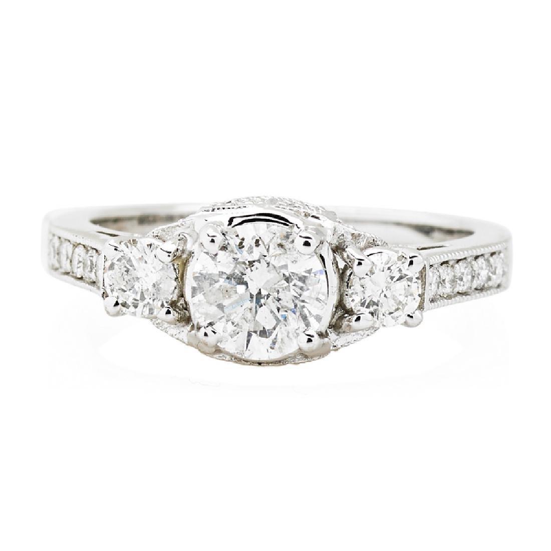 THREE STONE DIAMOND & WHITE GOLD RING