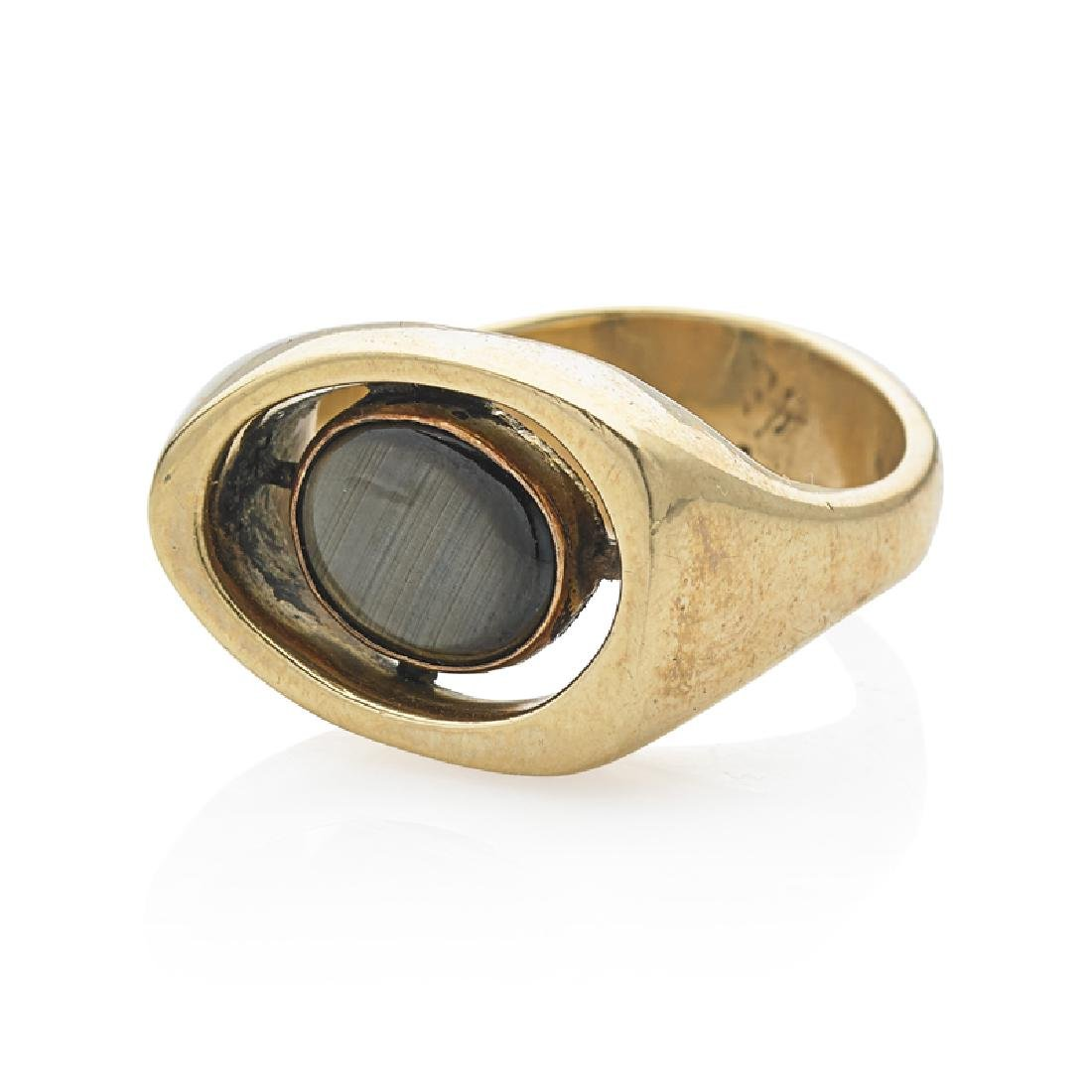 MODERNIST BLACK STAR SAPPHIRE & YELLOW GOLD RING