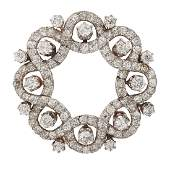 EDWARDIAN DIAMOND & PLATINUM TOPPED GOLD CIRCLE BROOCH