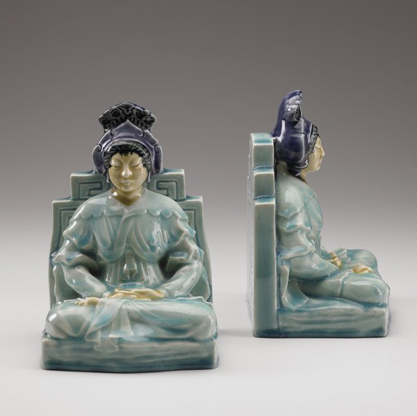 1016: ROOKWOOD Pair of porcelain bookends