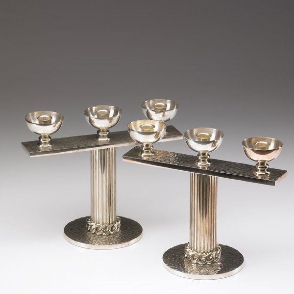 623: JEAN DESPRES Pair of silverplated candlesticks