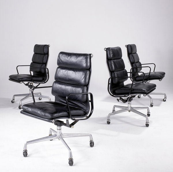 2: CHARLES AND RAY EAMES Four high back Soft-pad chairs