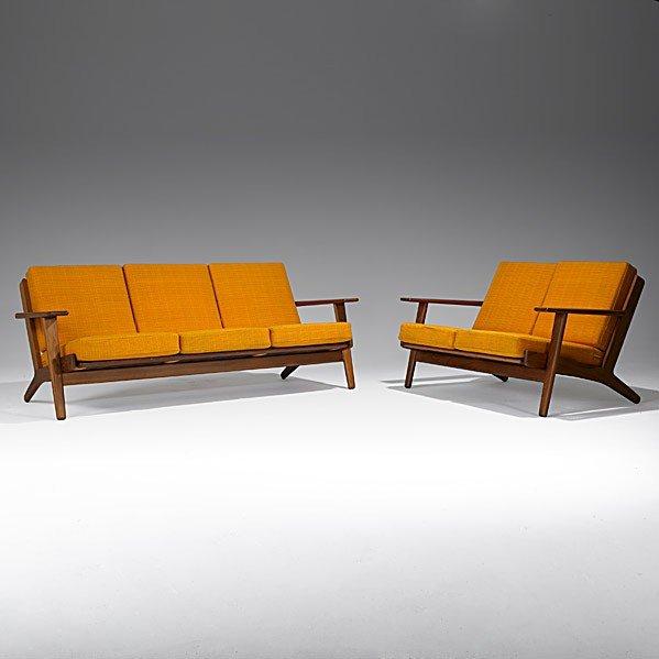 611: HANS WEGNER; GETAMA; Teak sofa and love seat