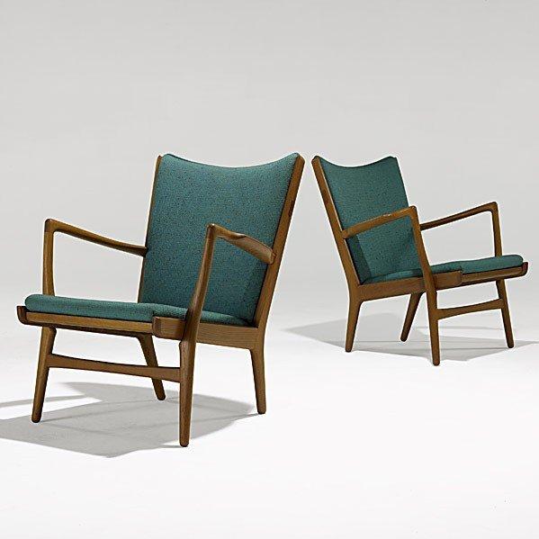 1007: HANS WEGNER; A.P. STOLEN; Pair of lounge chairs