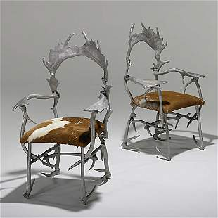 1310: ARTHUR COURT; Pair of antler chairs