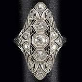 1101: DIAMOND AND PLATINUM FILIGREE NAVETTE RING