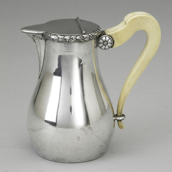 24: DUTCH SILVER AND IVORY SYRUP JUG BY BEGEER