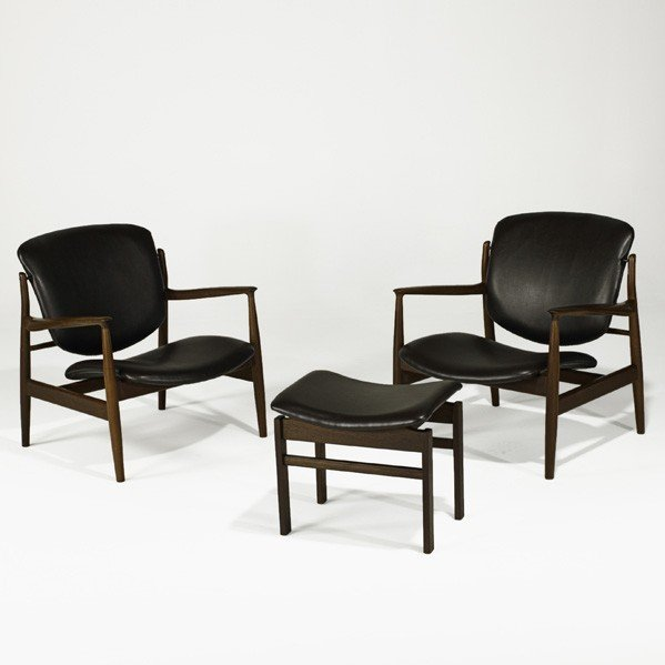 618: FINN JUHL; Pair of lounge chairs with ottoman