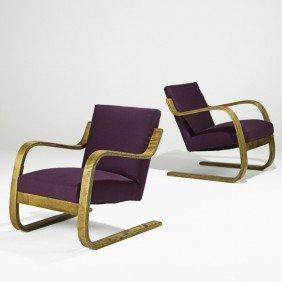 ALVAR AALTO; ARTEK; Pair Of Lounge Chairs