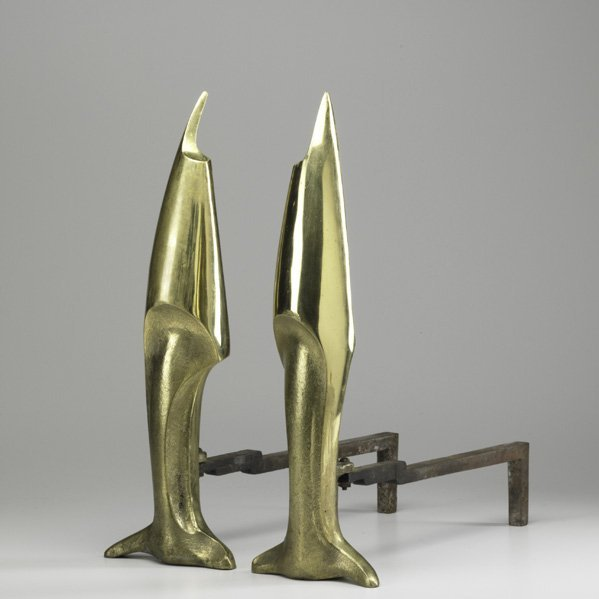 16: STYLE OF PIERRE LEGRAIN; Pair of andirons; Cast bra