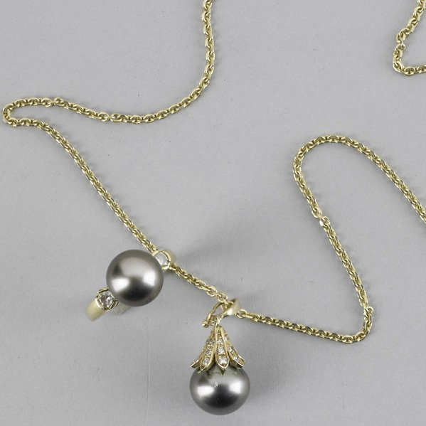 2005: BLACK PEARL AND DIAMOND NECKLACE AND RING