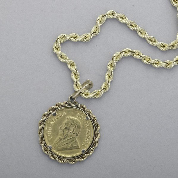 2023: COIN MEDALLION PENDANT ON GOLD CHAIN