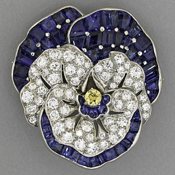 1425: OSCAR HEYMAN SAPPHIRE AND DIAMOND PANSY BROOCH