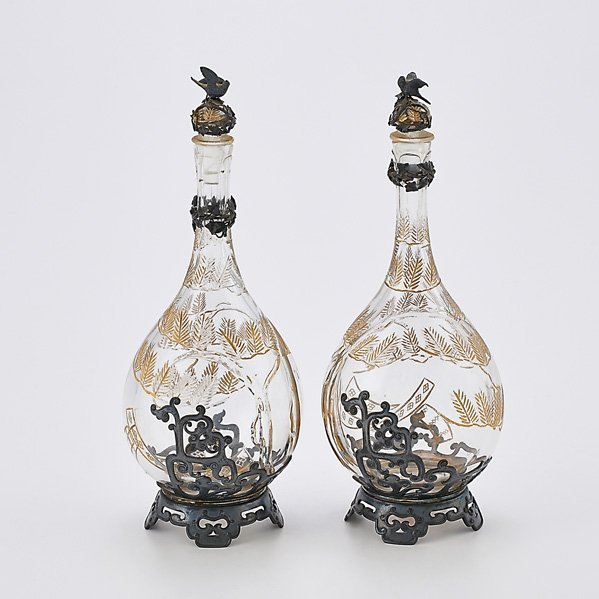 TWO SILVER MOUNTED CUT CRYSTAL SCENT BOTTLES