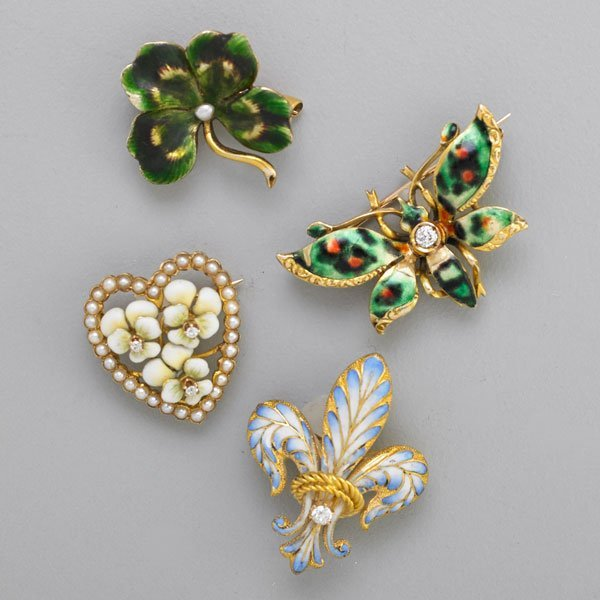FOUR AMERICAN BELLE EPOQUE ENAMELED GOLD BROOCHES