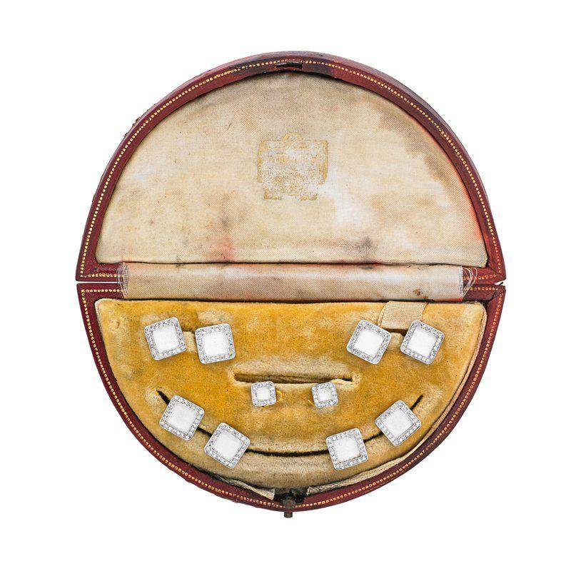 EDWARDIAN DIAMOND AND ENAMEL TUXEDO SET BY CARTIER