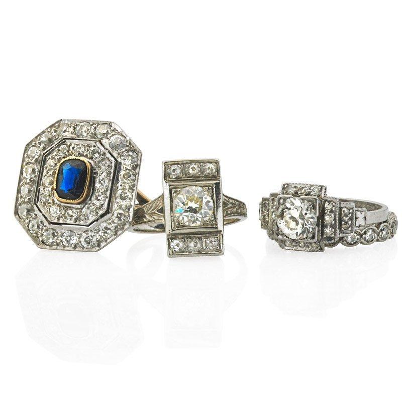 FOUR ART DECO DIAMOND OR SAPPHIRE RINGS