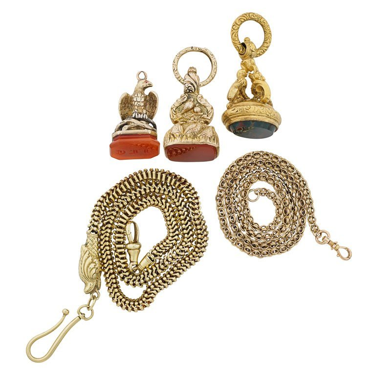 THREE ORNATE VICTORIAN FOBS, TWO CHAINS, MOST GOLD