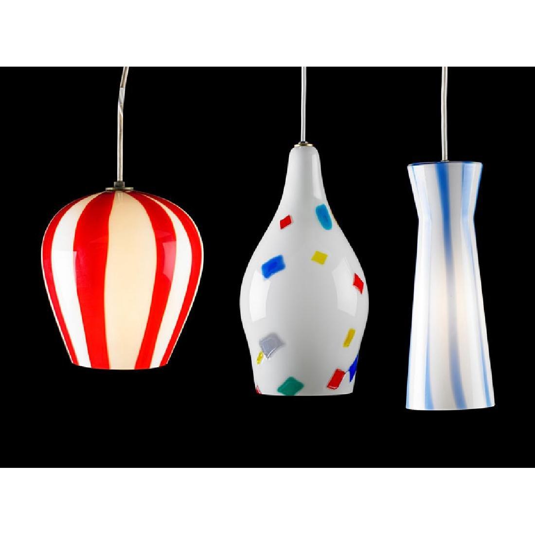 MASSIMO VIGNELLI; VENINI Three glass pendant lamps