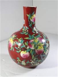 Elegant Qianlong Period Coral Red Vase with Bat & Peach