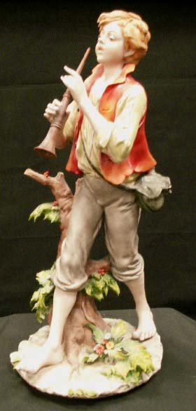 13: TRIADE ITALIAN PORCELAIN FIGURE OF A BOY
