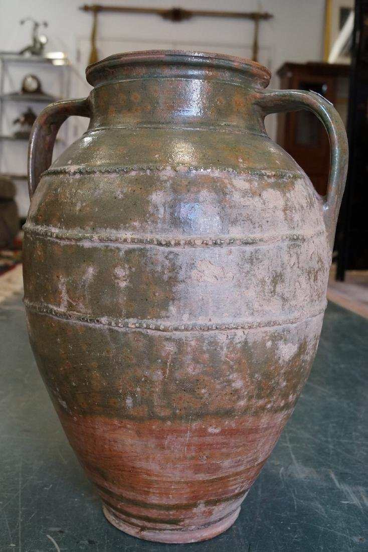 "EARLY GREEN GLAZED REDWARE JUG WITH HANDLES. HEIGHT 18"";"