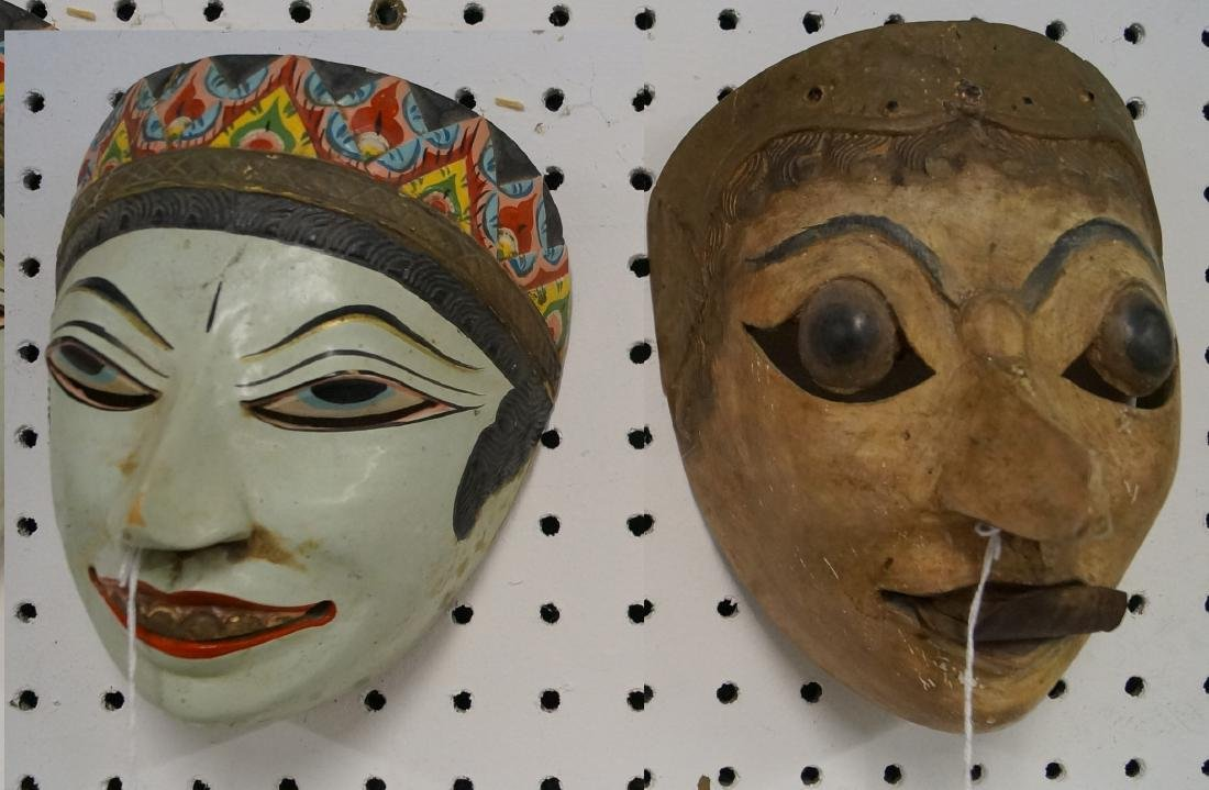 LOT (2) INDONESIAN CARVED AND PAINTED MASKS. HEIGHT 7-7