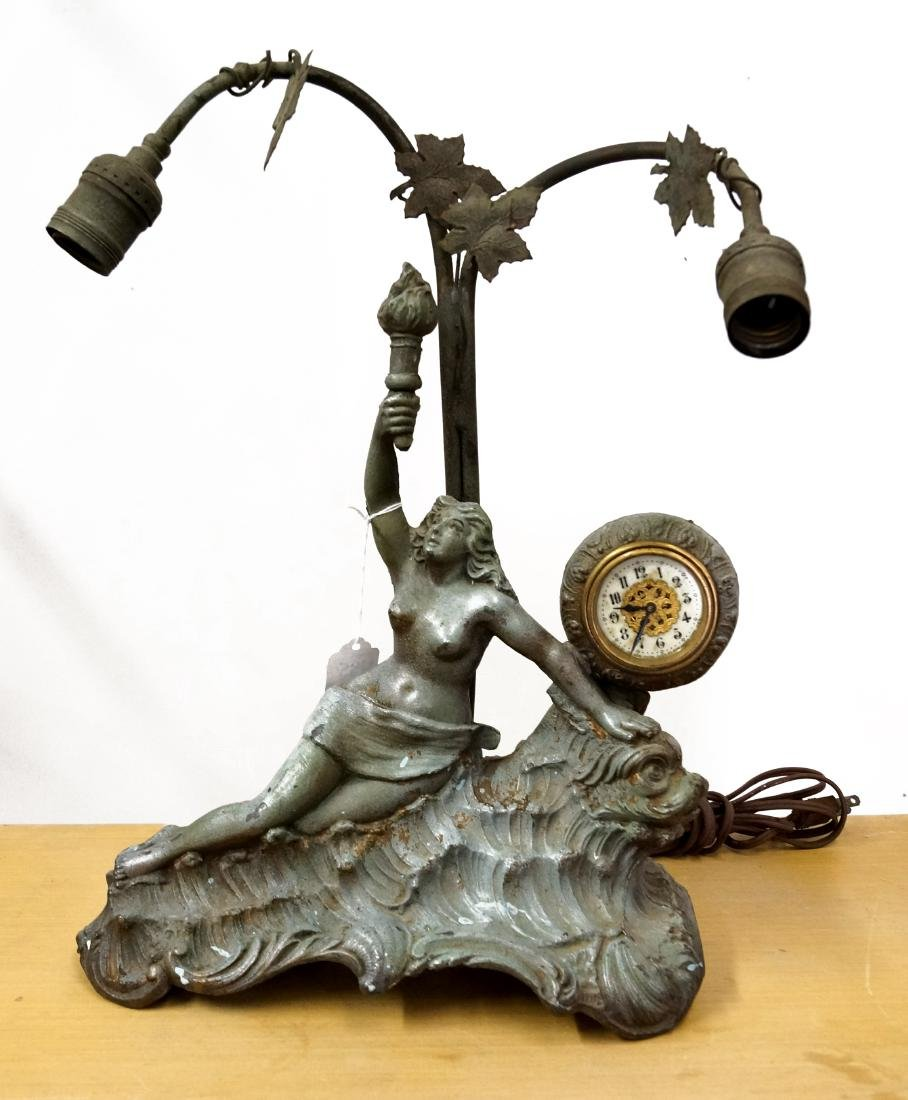 "PATINATED METAL FIGURAL CLOCK/LAMP. HEIGHT 16""; WIDTH"