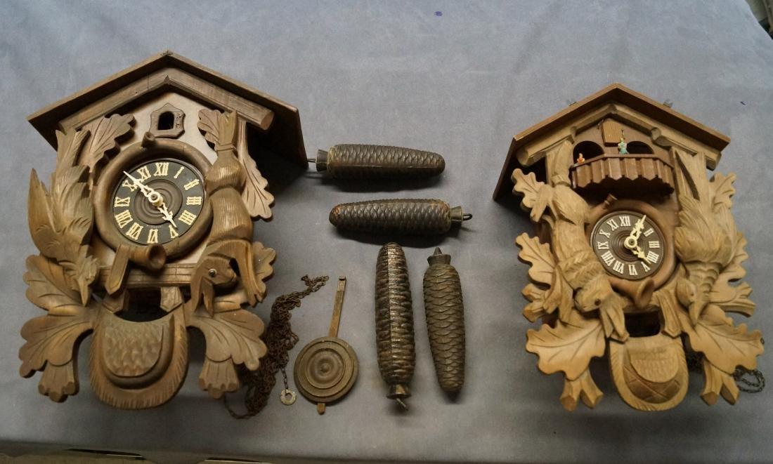 LOT (2) GERMAN BLACK FOREST CARVED CUCKOO CLOCKS.