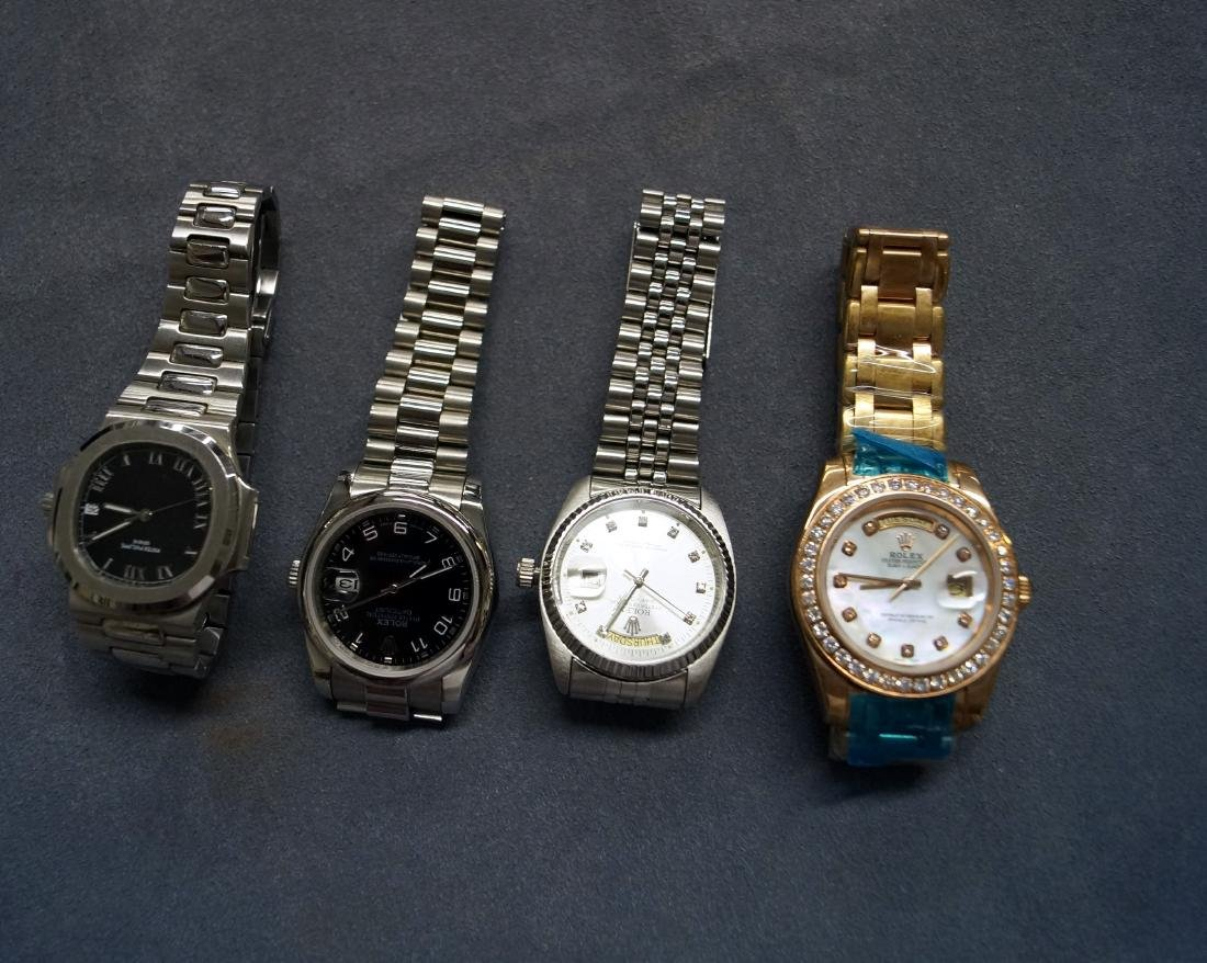 LOT (4) ASSORTED STAINLESS REPLICA WRISTWATCHES