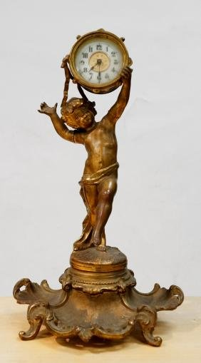 FRENCH STYLE GILT METAL FIGURAL CLOCK WITH CHERUB
