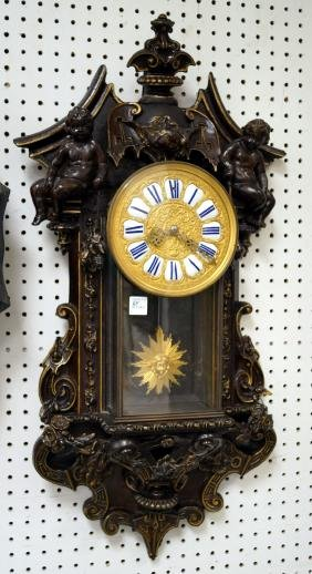 FRENCH CARVED AND PARCEL GILT FIGURAL WALL CLOCK, 19TH