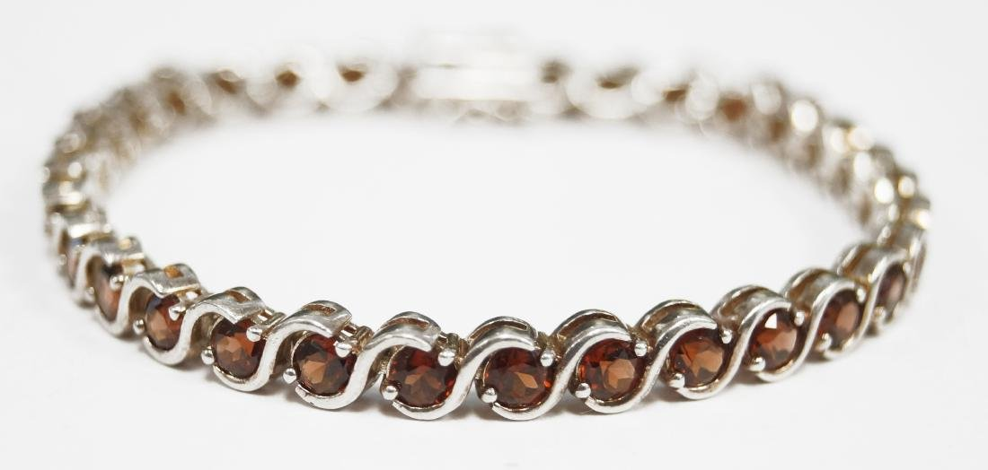 "925 STERLING AND GARNET LINE BRACELET. LENGTH 7 1/4"";"