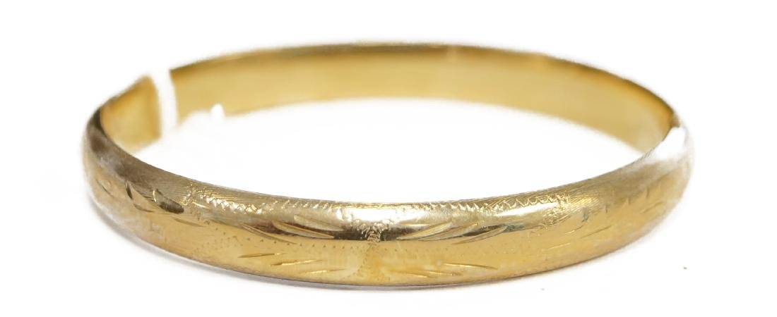 "14K YELLOW GOLD CHASED HINGED BANGLE. WIDTH 2 1/4"";"