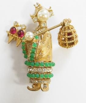 CINER GEISHA BROOCH WITH BEADS AND SWINGING BIRDCAGE.