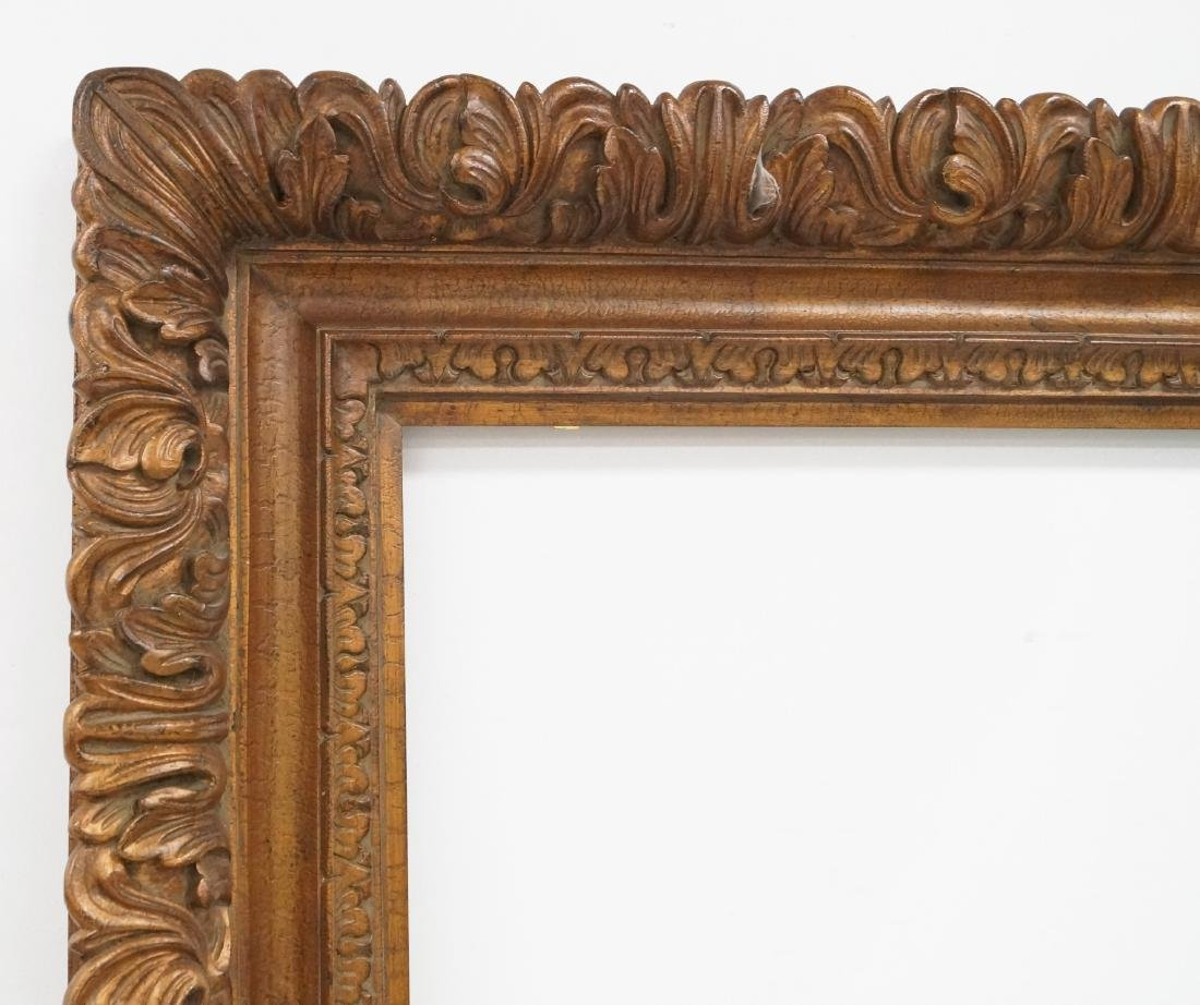MASSIVE CARVED AND GILT FRAME. INSIDE 72 X 48; OVERALL - 2