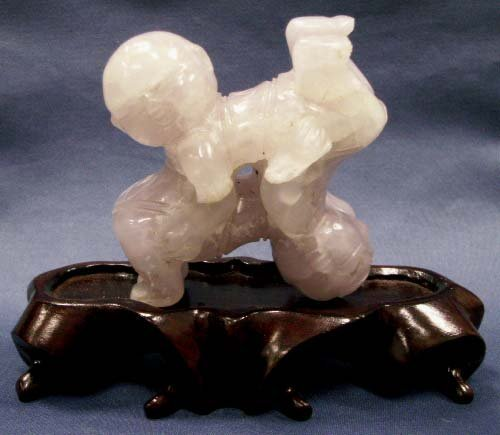 1016: CHINESE AMETHYST QUARTZ CARVED ACROBATS