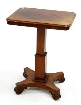 EMPIRE CARVED WALNUT TILT-TOP STAND, 19TH CENTURY.