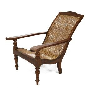 ANGLO-INDIAN TEAK PLANTATION CHAIR WITH CANED SEAT.