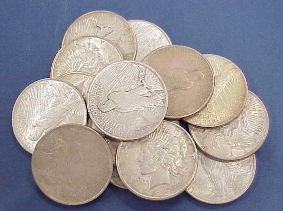 1023: LOT (14) ASSORTED PEACE SILVER DOLLARS
