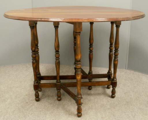 1019: MAHOGANY GATE-LEG TABLE, 19TH CENTURY