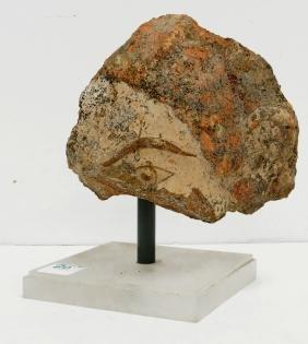 ETRUSCAN PAINTED TERRA COTTA HEAD FRAGMENT, C. 700 BC.