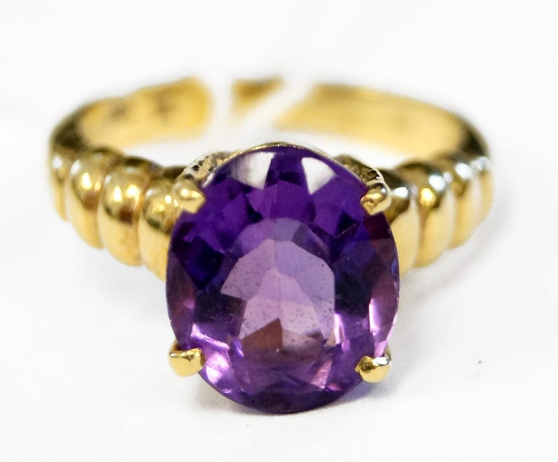 14K YELLOW GOLD AND 2.78 CT OVAL-CUT AMETHYST RING.