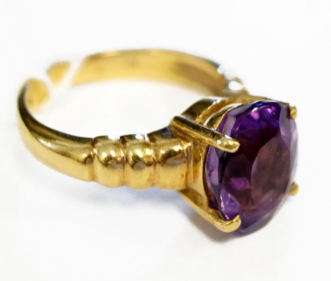 14K YELLOW GOLD AND 2.78 CT OVAL-CUT AMETHYST RING. - 2