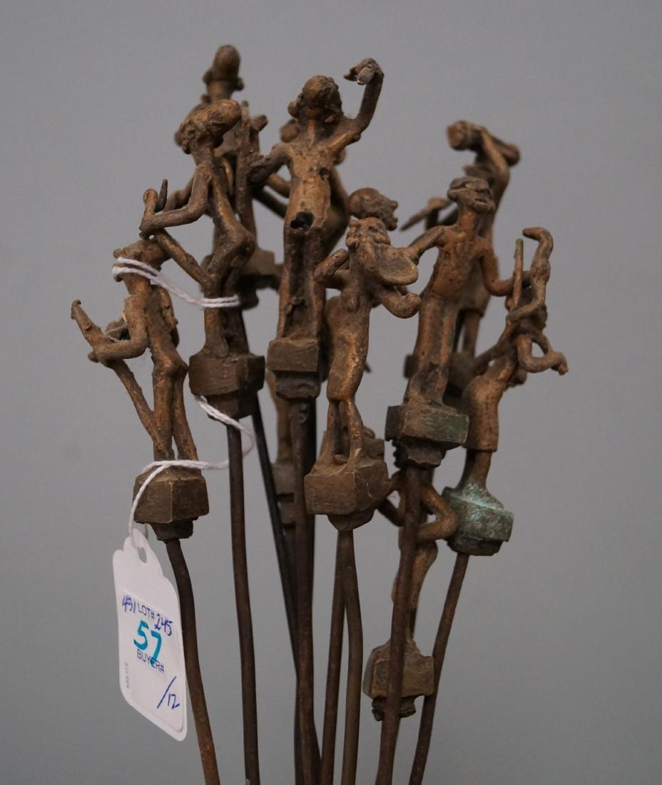 LOT (12) ASHANTI, GHANA, BRONZE FIGURAL SKEWERS. LENGTH