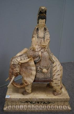 CHINESE CARVED BONE FIGURE OF KWAN YIN UPON AN
